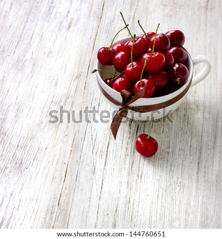 fresh red cherries on texture vintage white background