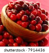 Fresh red cranberries in a wooden bowl - stock photo