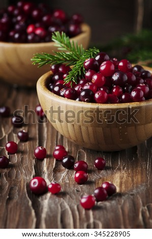 Fresh red cranberry on the vintage table, selective focus - stock photo