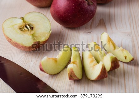 fresh red cut and sliced apple on cutting board