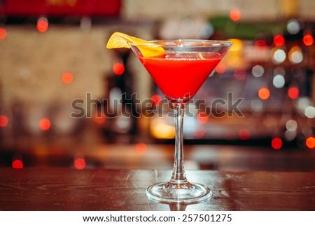 Fresh red frozen cocktail on a color background blur bokeh (bar, club, restaurant) - stock photo
