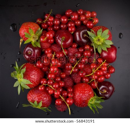 fresh red  fruit on black background - stock photo