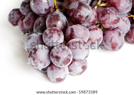 Fresh red grape isolated on white - stock photo