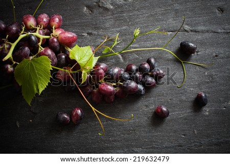 Fresh red grapes on dark background - stock photo