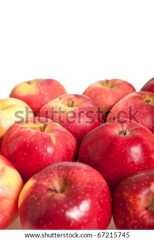 Fresh red juicy natural apples on white isolated background - stock photo