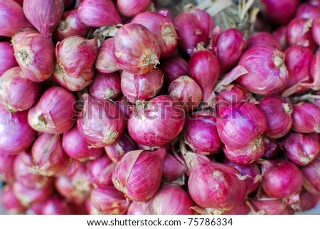 Fresh red onions in market closeup view as background - stock photo