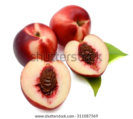 fresh red peach with green leaf on white background