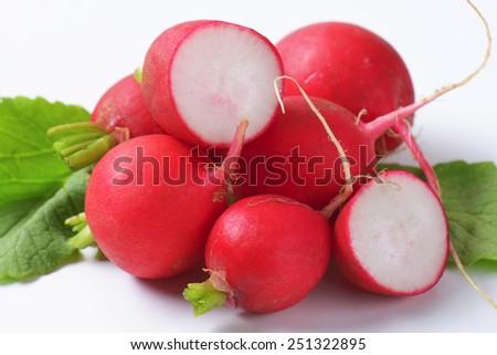 Fresh red radishes on white background - stock photo