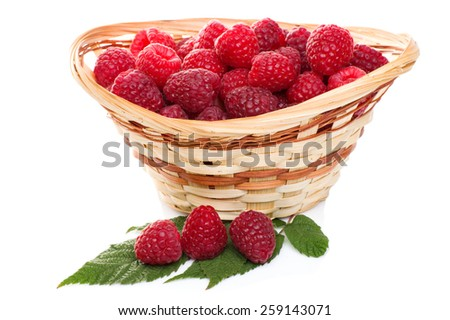 fresh red raspberries in the basket isolated on white background - stock photo