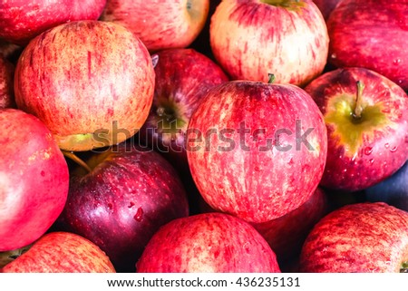 Fresh red ripe apples in market