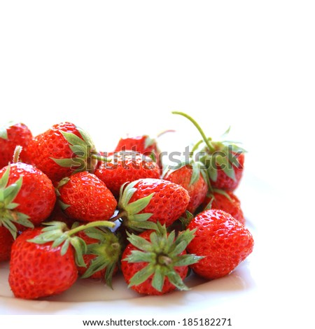 Fresh red ripe strawberries - isolated on white - stock photo