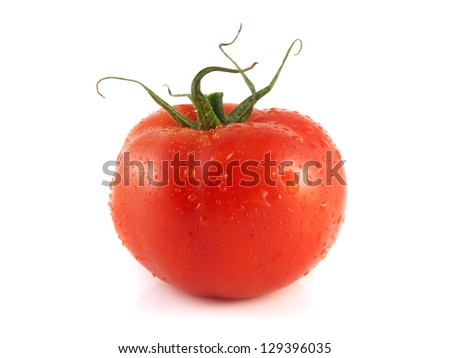 Fresh red ripe tomato. Isolated on a white background.