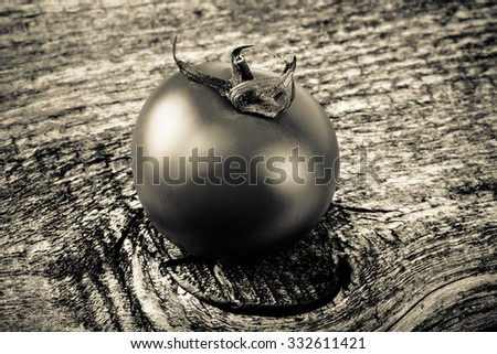 Fresh, red, ripe tomatoes on old grey wood background. Toned. - stock photo