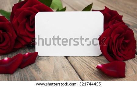 Fresh Red roses on a wooden background - stock photo