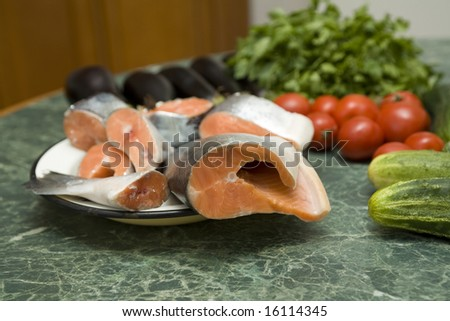 Fresh red salmon fish with vegetable cucumber and tomato