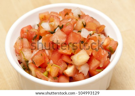 Fresh Red Salsa on a wooden background