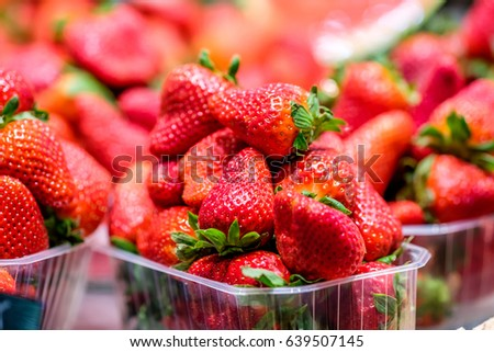Fresh red strawberries for sale at marketplace