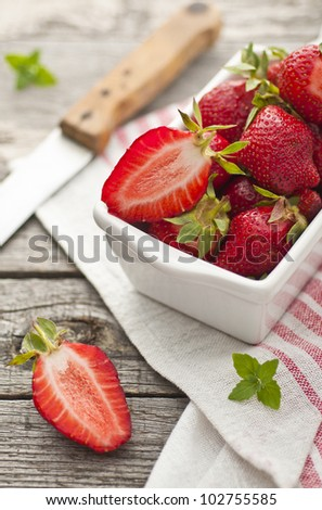 Fresh red strawberries in a dish - stock photo