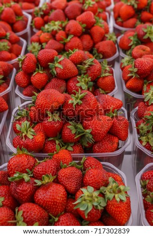 fresh red strawberries, put up for sale on the market.