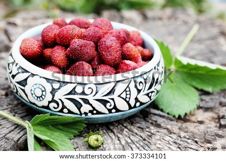 Fresh red strawberries. Wild small strawberry of the woods - stock photo