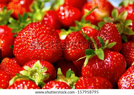 Fresh, red strawberries with green petiole