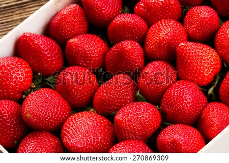 fresh red strawberry in wooden crate close up - stock photo