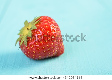 Fresh Red Strawberry On Blue Wood Boards Background