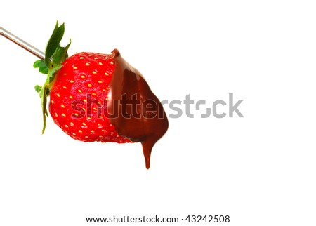 Fresh red strawberry with dark chocolate sauce dripping off of it - stock photo