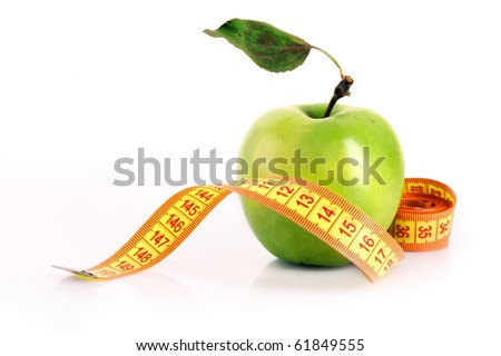 Fresh red tasty apple with measuring tape isolated on white - stock photo