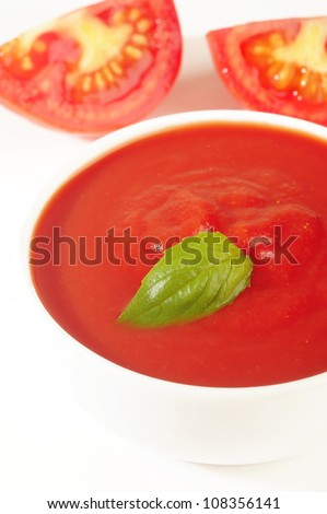 fresh red tomato sauce with basil leaf