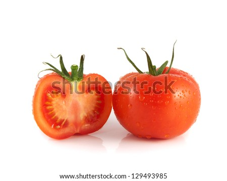 Fresh red tomato with sliced half. Isolated on a white background. - stock photo