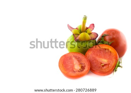 Fresh red tomatoes and garcinia isolated on white