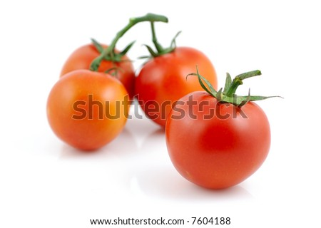 Fresh red tomatoes in isolated white background