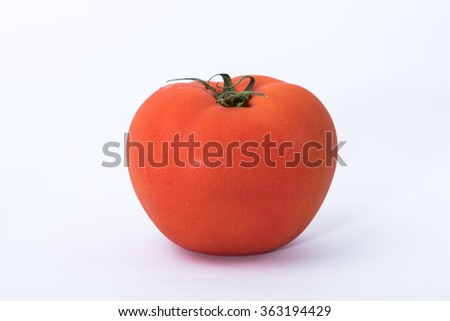 Fresh red tomatoes isolated on white.