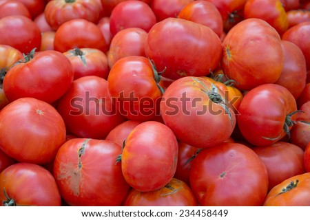Fresh red tomatoes on display in a market. Majorca, Balearic islands, Spain.