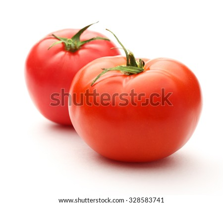 Fresh red tomatoes on the white background
