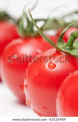 fresh red tomatoes on white background - stock photo