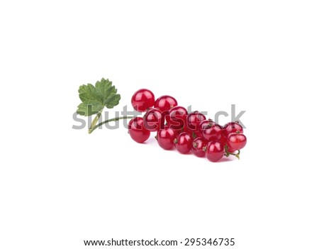 Fresh redcurrants with a leaf isolated on white background