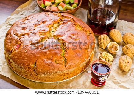 Fresh rhubarb cake with nutts and honey - stock photo