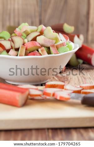 Fresh rhubarb on cutting board. Shallow dof - stock photo