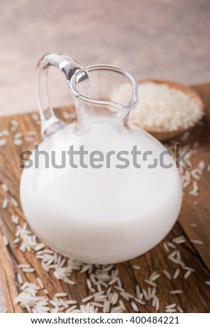 Fresh rice milk in glass pitcher. Healthy, lactose intolerance, diet and vegan concept.
