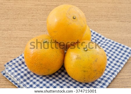 Fresh Ripe and Sweet Oranges on A Wooden Table, Orange Is The Fruit of The Citrus Species. - stock photo