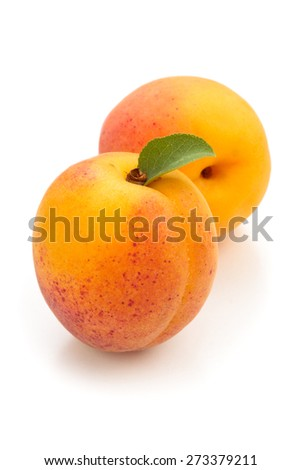 Fresh ripe apricots with leaf. Isolated on white background. - stock photo