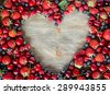 Fresh ripe berries, cherries, raspberries, blueberries copy space background, summer fruits, harvest concept, vitamins food, heart shaped - stock photo