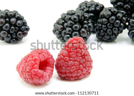 Fresh ripe blackberry and Raspberry  on a white background. - stock photo