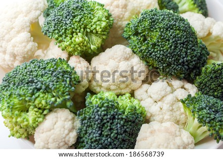 Fresh ripe broccoli piece and cauliflower cabbage vegetables - stock photo