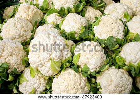 Fresh ripe cauliflower for sale in a market - stock photo