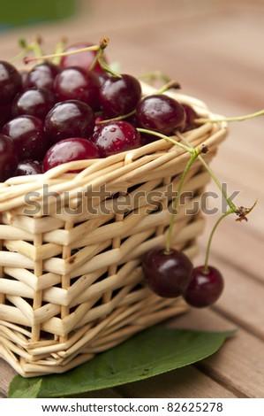 Fresh ripe cherries in a basket - stock photo