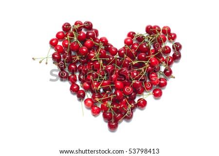 Fresh ripe cherry in shape of heart - stock photo