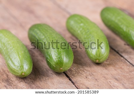 fresh ripe cucumber on a wooden background